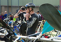26 MAY 2013 - BRIGG, GBR - A competitors prepares in transition before the start of the 2013 Brigg Bomber Quadrathlon, a World Quadrathlon Federation World Cup round and the British Championships, held in Brigg in Lincolnshire, Great Britain .(PHOTO (C) 2013 NIGEL FARROW)