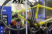 A visitor looks at the latest offering at the 14th China International Bicycle Fair in Shanghai, China. Despite the government's push to promote automobile ownership, the bicycle remains the most popular mode of transportation for China's masses. However gone are the ubiquitous and simple clunkers of the old days, more are looking into newer, lighter, and fancier models..14-APR-04