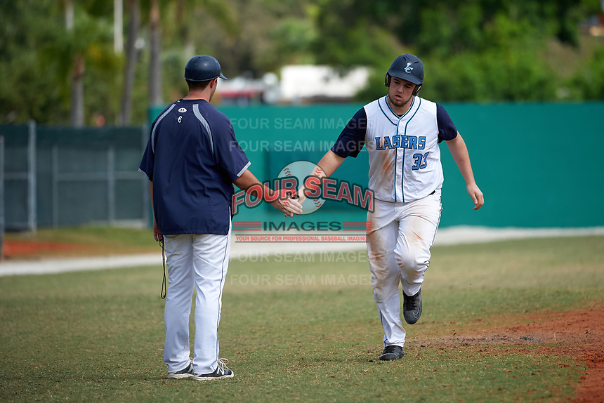 Lasell Lasers Dom Mascolo (33) after hitting a home run during the first game of a doubleheader against the Edgewood Eagles on March 14, 2016 at Terry Park in Fort Myers, Florida.  Edgewood defeated Lasell 9-7.  (Mike Janes/Four Seam Images)