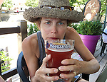 Backroads bicyclist  Sandra Gallantine of Lincoln, Nebraska enjoys a beer with her lunch.