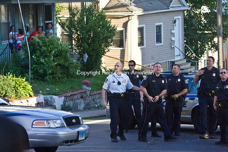 WATERBURY, CT - 06 JUNE 2010 -060610JT07-<br /> Waterbury Police react after an item was thrown at them from a house on Baldwin Street near the intersection of Lounsbury Street in Waterbury on Sunday.<br /> Josalee Thrift Republican-American