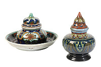 BNPS.co.uk (01202 558833)<br /> Pic: Duke's/BNPS<br /> <br /> A colourful Den Haag inkwell and cover<br /> <br /> A collection of pottery that belonged to late Blue Peter presenter John Noakes is being sold by his widow for around £10,000.<br /> <br /> The 29 pieces of Rozenburg porcelain were collected by the 1970s TV star right up until his death, three years ago in 2017.<br /> <br /> Since then they have been in the ownership of his wife Vicky who has now decided the time is right to put them on the market.