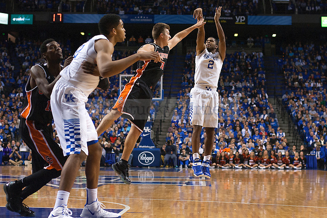 Guard Aaron Harrison of the Kentucky Wildcats shoots a three during the second half of the game against the University of Georgetown Tigers at Rupp Arena on Sunday, November 9, 2014 in Lexington, Ky. Kentucky defeated Georgetown 121-52. Photo by Michael Reaves | Staff