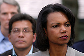 Camp David, MD - June 12, 2006 -- United States Secretary of State Condoleezza Rice watches as President George W. Bush speaks to members of the press about his meetings with top advisors at Camp David. President Bush held the meetings to reassess US military strategy in the war in Iraq.  Attorney General Alberto Gonzales is at left.<br /> Credit: Evan F. Sisley - Pool via CNP