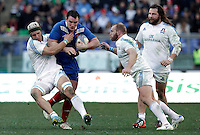 Rugby, torneo Sei Nazioni 2013: Italia vs Francia. Roma, stadio Olimpico, 3 febbraio 2013..France's Louis Picamoles is challenged by Italy's Francesco Minto, left, and Leonardo Ghiraldini, as Martin Castrogiovanni, right, looks on, during the Six Nations rugby union international match between Italy and France, at Rome's Olympic stadium, 3 February 2013..UPDATE IMAGES PRESS/Riccardo De Luca