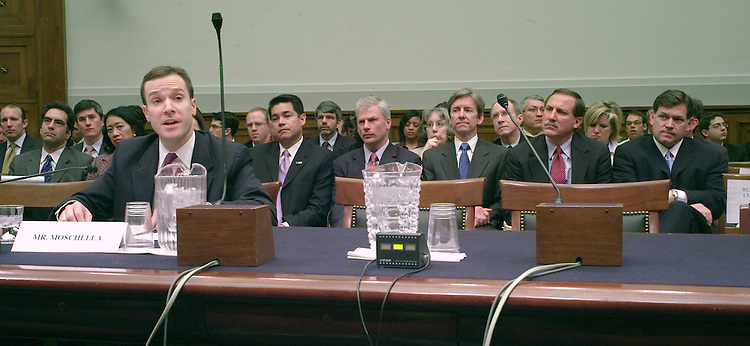 "03/06/07--William E. Moschella, a deputy attorney general, is sworn in during the House Judiciary Commercial and Administrative Law Subcommittee hearing on the dismissal of (in background) David C. Iglesias, John McKay, Paul K. Charlton, Daniel G. Bogden, and H.E. Cummins III, and other former U.S. attorneys who were asked to resign last year by the Bush administration. Moschella told the panel that the Justice Department preferred not to release any information about why the prosecutors were dismissed Òout of respect for the U.S. attorneys at issue ... ""In hindsight, perhaps this situation could have been handled better,Ó Moschella said. ""Unfortunately, our failure to provide reasons to these individual U.S. attorneys has only served to fuel wild and inaccurate speculation about our motives.Ó Both the House and Senate Judiciary panels are investigating the dismissal of eight U.S. attorneys and their replacement by interim appointees who can serve indefinitely and do not require Senate confirmation. Democrats want to repeal that authority, created by a provision in the reauthorization (PL 109-177) last year of the 2001 anti-terrorism law known as the Patriot Act. Aside from seeking to gain support for repeal legislation (HR 580, S 214), the panels are probing allegations of misconduct by members of Congress. Rep. Heather A. Wilson and Sen. Pete V. Domenici, who are New Mexico Republicans, have both admitted contacting one of the eight prosecutors about public corruption investigations. Earlier on Tuesday the attorneys told the Senate Judiciary Committee that the Justice Department pressured them not to speak publicly about their dismissals. Justice Department spokesman Brian Roehrkasse said that assertion was Òridiculous and not based on fact.Ó Congressional Quarterly Photo by Scott J. Ferrell"