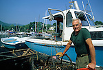 Lobsterman at his float in Camden Harbor, Camden, Maine, USA