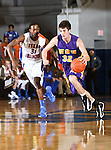 Hardin-Simmons Cowboys forward Jim Walter (32) drives down court in the game between the UTA Mavericks and the Hardin-Simmons Cowboys held at the University of Texas in Arlington's Texas Hall in Arlington, Texas. UTA defeats Hardin-Simmons 88 to 71.