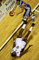 Saints guard Luke Martin sends Heat import Mychal Green flying during the National Basketball League match Wellington Saints and Harbour Heat at TSB Bank Arena, Wellington, New Zealand on Saturday 13 June 2009. Photo: Dave Lintott / lintottphoto.co.nz