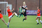 Vicky Krug (4) of the Wake Forest Demon Deacons kicks the ball out of the air in front of Shannon Horgan (7) of the Clemson Tigers during second half action at Riggs Field on October 22 2017 in Clemson, South Carolina.  The Tigers defeated the Demon Deacons 2-1. (Brian Westerholt/Sports On Film)