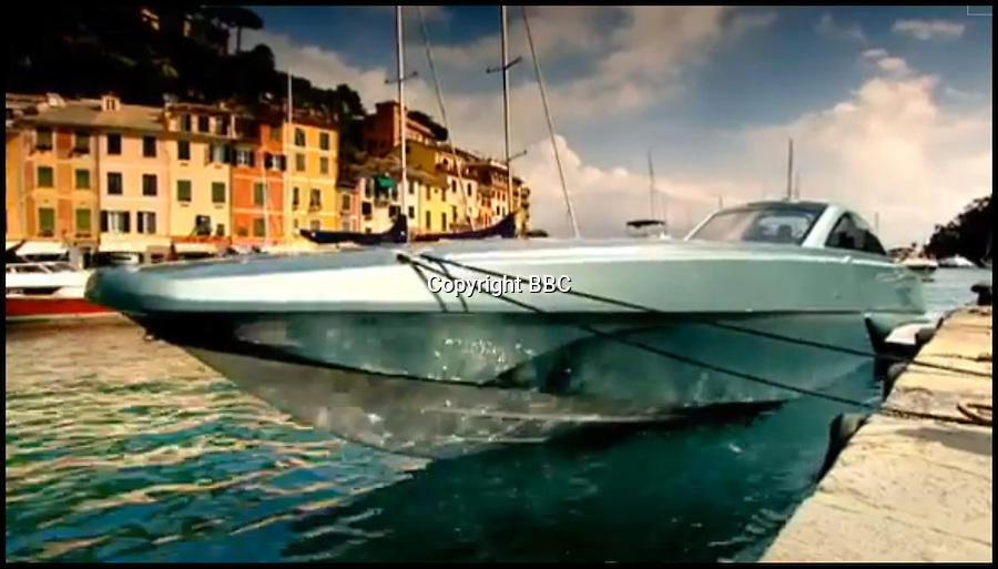 BNPS.co.uk (01202) 558833<br /> Picture: BBC<br /> <br /> A luxury model was driven by TV presenter James May in a race against Richard Hammond's Ferrari Daytona from Portofino, Italy, to St Tropez, France in 2009.<br /> <br /> This James Bond-style powerboat made from Kevlar and carbon fibre was built to chase down pirates with its remote controlled machine gun and 100mph speeds. But now the cutting edge boat - the fastest military vessel ever made - is being sold with no reserve and is tipped to sell for a fraction of its &pound;1.5 million value. It was dubbed &quot;the Bugatti Veyron of the seas&quot; at it's launch, and Top Gear host Jeremy Clarkson called it &quot;the most beautiful thing ever created by man&quot;. But seven years on the 48ft superboat is among 300 lots including two other incomplete boats being sold off by manufacterers XSMG World to recover money owed to HM Revenue and Customs.