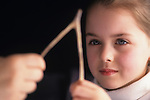 Mother and daughter pulling on a wishbone close up of hands Bothell Washington State USA  MR