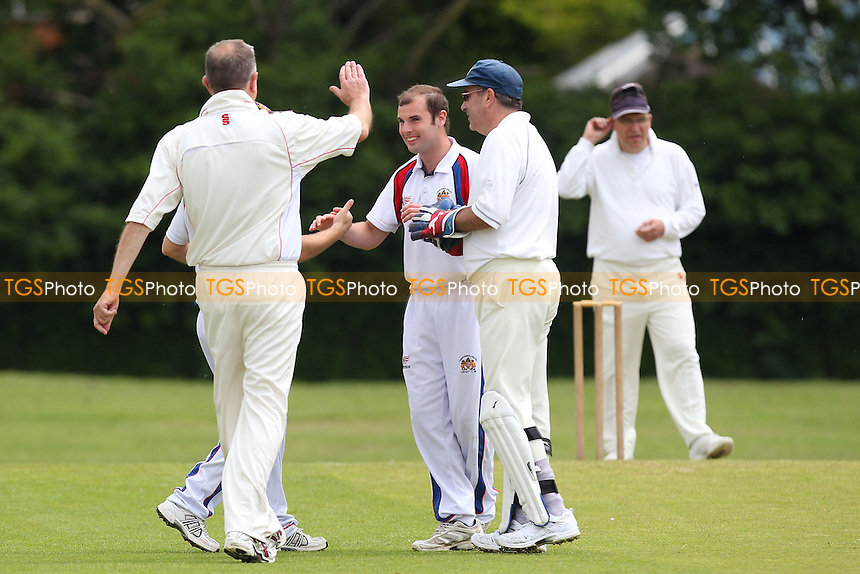 S Hunt of Hornchurch Athletic celebrates the wicket of A Ali - Hornchurch Athletic CC 3rd XI vs Goresbrook CC 3rd XI - Mid-Essex Cricket League - 31/05/14 - MANDATORY CREDIT: Gavin Ellis/TGSPHOTO - Self billing applies where appropriate - 0845 094 6026 - contact@tgsphoto.co.uk - NO UNPAID USE