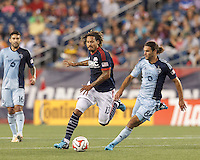 Foxborough, Massachusetts - September 3, 2014: First half action. In a Major League Soccer (MLS) match, the New England Revolution (blue/white) vs Sporting Kansas City (light blue), 1-1 (halftime), at Gillette Stadium.