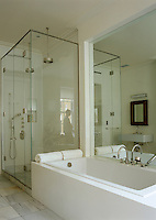 This spacious bathroom has room for a twin-headed shower as well as a large bath