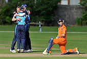 Cricket One Day International - Scotland V The Netherlands at Mannofield - Aberdeen - The Winning Moment! - Netherlands batsman Tom Cooper (who once played league cricket in Scotland for Forfarshire CC) is bowled by Josh Davey ( left, looking back) to give Scotland a 15 run victory - Cooper top-scored for the Dutch with 75 runs - Scotland keeper is Gregor Maiden - Picture by Donald MacLeod - 28.6.11 - 07702 319 738 - www.donald-macleod.com