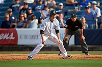 New York Yankees pinch runner Tyler Wade (94) leads off first base as umpire Vic Carapazza looks on during a Spring Training game against the Detroit Tigers on March 2, 2016 at George M. Steinbrenner Field in Tampa, Florida.  New York defeated Detroit 10-9.  (Mike Janes/Four Seam Images)