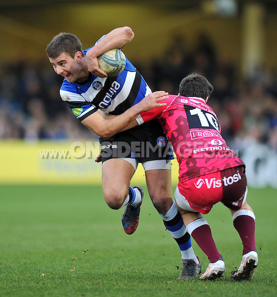 Ollie Devoto is tackled by Edorado Padovani. Amlin Challenge Cup match, between Bath Rugby and Mogliano Rugby on December 14, 2013 at the Recreation Ground in Bath, England. Photo by: Patrick Khachfe / Onside Images