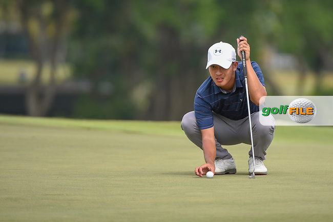 Lloyd Jefferson GO (PHI) lines up his putt on 18 during Rd 3 of the Asia-Pacific Amateur Championship, Sentosa Golf Club, Singapore. 10/6/2018.<br /> Picture: Golffile   Ken Murray<br /> <br /> <br /> All photo usage must carry mandatory copyright credit (© Golffile   Ken Murray)