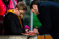 Recently retired Ryan Mason signs autograph book for young fan during the Sky Bet Championship match between Hull City and Sheff United at the KC Stadium, Kingston upon Hull, England on 23 February 2018. Photo by Stephen Buckley / PRiME Media Images.