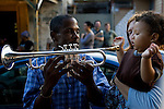 A first birthday party for Hector Campbell born on 8/28/05, one day before Hurricane Katrina hit New Orleans. He was born in Touru Hospital located in New Orleans. His Father Mervin Campbell is a trumpeter for the Treme Brass Band who paraded with him in his arms in the neighborhood of Treme.
