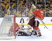 Clay Witt (Northeastern - 31), Kevin Hayes (BC - 12), Josh Manson (Northeastern - 3) - The Boston College Eagles defeated the Northeastern University Huskies 7-1 in the opening round of the 2012 Beanpot on Monday, February 6, 2012, at TD Garden in Boston, Massachusetts.