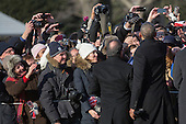 United States President Barack Obama, center, and President Francois Hollande, left, shake hands with attendees during an arrival ceremony on the South Lawn of the White House in Washington, D.C., U.S., on Tuesday, Feb. 11, 2014. <br /> Credit: Andrew Harrer / Pool via CNP