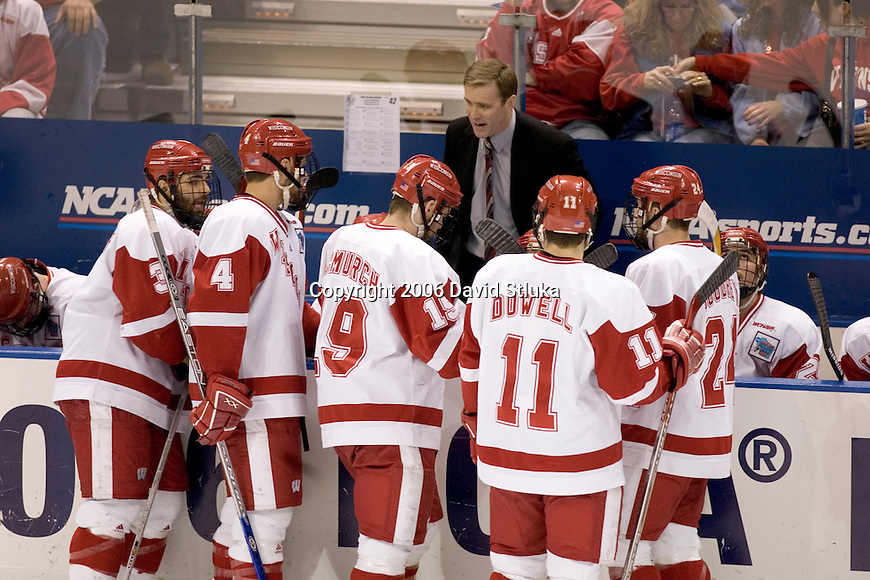 MILWAUKEE, WI - APRIL 8: Head coach Mike Eaves of the Wisconsin Badgers talks to his players during the game against the the Boston College Eagles during the NCAA Frozen Four Finals on April 8, 2006 at the Bradley Center in Milwaukee, Wisconsin. Wisconsin beat Boston College 2-1. (Photo by David Stluka)