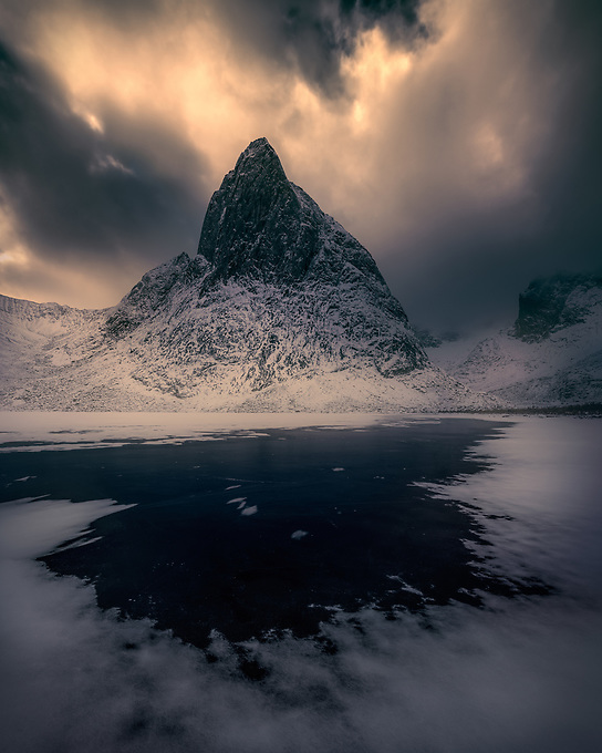 The patterns of snow on Divide Lake  changed almost daily with the wind and freezing temperatures.  Here, a brief interlude to a cloudy afternoon, as the light reveals itself behind Shark's Tooth peak in the Yukon Territory.