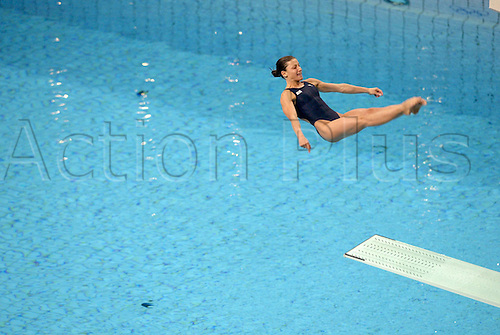 25 August 2004: Russian diver YULIA PAKHALINA (RUS) dives during the Women's 3m Springboard Preliminary round at The Olympic Aquatic Centre. 2004 Olympic Games, Athens, Greece. Photo: Neil Tingle/Action Plus...040825 dives watersport diving