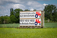 British pork & Red Tractor sign dispalyed in a farmers field on the side of the road