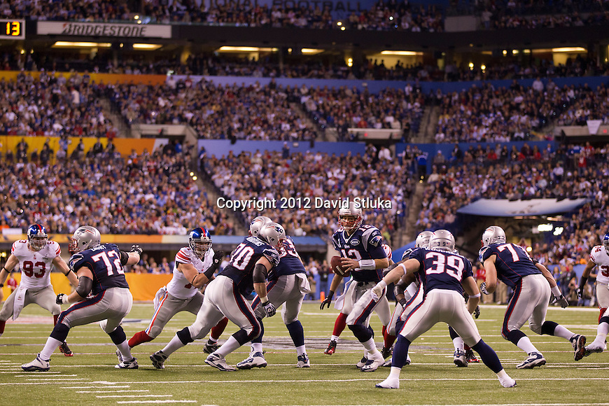 New England Patriots quarterback Tom Brady (12) runs a play during the NFL Super Bowl XLVI football game against the New York Giants on Sunday, Feb. 5, 2012, in Indianapolis. The Giants won 21-17 (AP Photo/David Stluka)...