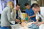 Fourth-year medical students work together to figure out a patient's ailment and administer the proper treatment in the Simulation ICU of the Trent Semans Center for Health Education. From left are Gillian Smelick, Tyler Hobbs, Christophe Hansen-Estruch, and Phillip Tseng.