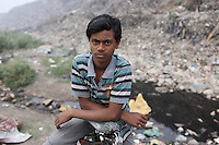 A young Indian boy near the Dhapa landfill, the destination for much of Kolkata's solid waste over the past 30 years. It is estimated that only 10 percent of Kolkata's waste is recycled, contributing to the growing problem of waste that is sitting just a couple of kilometres from the city's downtown area. India. November, 2013
