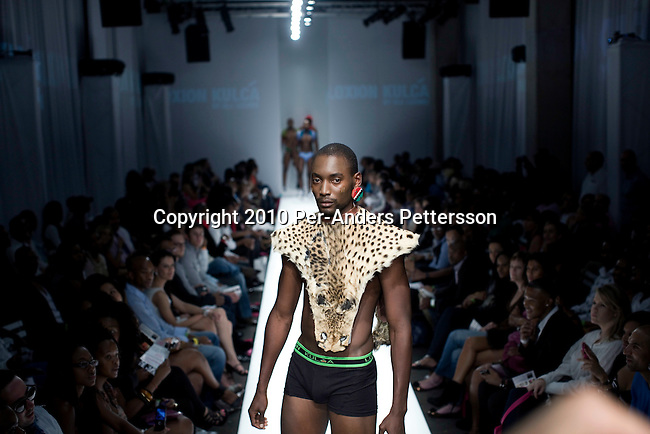 JOHANNESBURG, SOUTH AFRICA - MARCH 27: A model shows clothes from the Loxion Kulca by Ole Ledimo brand on the catwalk at the South African fashion week on March 27, 2010, Turbine Hall in central Johannesburg, South Africa. Buyers and celebrities watched the 3 day fashion week. (Photo by Per-Anders Pettersson)