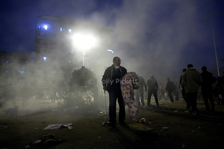 A man used a cane to walk around Tahrir Square, surveying the damage, after the Egyptian army and Central Security Forces tried to clear the square of protesters on Sunday, Nov. 20, 2011. Soldiers burned down protesters tents and beat people with clubs, but a short time later, the demonstrators returned.