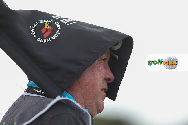 In resting the ping lag on the shoulder of caddie Jimmy, Paul McGinley (IRL) creates a witch-like hat for the Scotsman much to the delight of the former Ryder Cup Captain during Round Three of the 2015 Dubai Duty Free Irish Open Hosted by The Rory Foundation at Royal County Down Golf Club, Newcastle County Down, Northern Ireland. 30/05/2015. Picture David Lloyd | www.golffile.ie