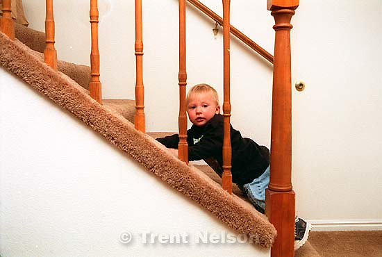 Noah Nelson climbing stairs at Erica McMahon's 3rd birthday party.<br />