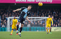Matt Bloomfield of Wycombe Wanderers heads the ball forward during the Sky Bet League 2 match between Wycombe Wanderers and Bristol Rovers at Adams Park, High Wycombe, England on 27 February 2016. Photo by Andy Rowland.