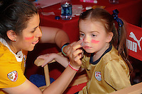 Face painting during the Women's Professional Soccer (WPS) All-Star Game at KSU Stadium in Kennesaw, GA, on June 30, 2010.