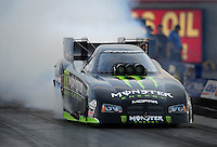 Oct. 31, 2008; Las Vegas, NV, USA: NHRA funny car driver Tommy Johnson Jr does a burnout during qualifying for the Las Vegas Nationals at The Strip in Las Vegas. Mandatory Credit: Mark J. Rebilas-
