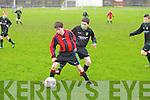 Kingdom Boys Graham Hudson and Mastergeeha FC's Sean O'Keeffe.