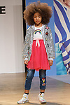 Model walks runway in an outfit from the Lola & The Boys collection during the petitePARADE fashion show at Children's Club in the Jacob Javits Center in New York City on February 25, 2018.