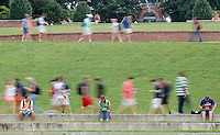 Clemson students walk past their classmates sitting in the school's amphitheater on Monday. Classes were held on campus despite the Labor Day holiday.