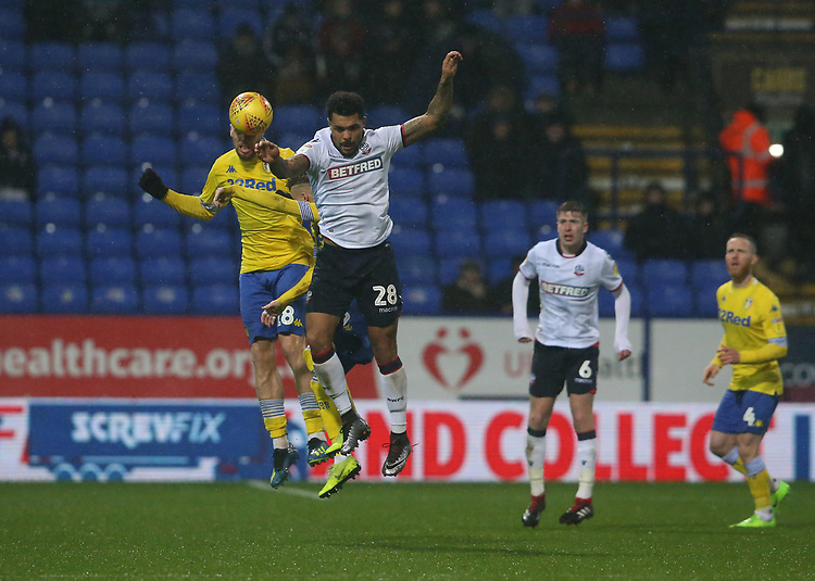 Leeds United's Pontus Jansson and Bolton Wanderers' Josh Magennis<br /> <br /> Photographer Stephen White/CameraSport<br /> <br /> The EFL Sky Bet Championship - Bolton Wanderers v Leeds United - Saturday 15th December 2018 - University of Bolton Stadium - Bolton<br /> <br /> World Copyright © 2018 CameraSport. All rights reserved. 43 Linden Ave. Countesthorpe. Leicester. England. LE8 5PG - Tel: +44 (0) 116 277 4147 - admin@camerasport.com - www.camerasport.com