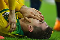 1st December 2019; Carrow Road, Norwich, Norfolk, England, English Premier League Football, Norwich versus Arsenal; Kenny McLean of Norwich City in considerable pain from the challenge by Granit Xhaka of Arsenal - Strictly Editorial Use Only. No use with unauthorized audio, video, data, fixture lists, club/league logos or 'live' services. Online in-match use limited to 120 images, no video emulation. No use in betting, games or single club/league/player publications