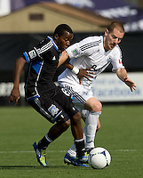 Marvin Chavez of Earthquakes fights for the ball against Jordan Harvey of Whitecaps during the game at Buck Shaw Stadium in Santa Clara, California on April 7th, 2012.  San Jose Earthquakes defeated Vancouver Whitecaps, 3-1.
