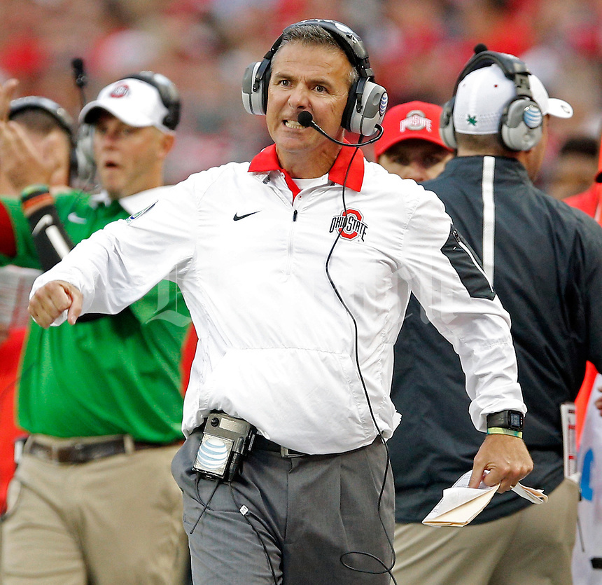 Ohio State Buckeyes head coach Urban Meyer yells at his offense as they take on Western Michigan Broncos in the 4th quarter of their game at Ohio Stadium on September 26, 2015.  (Dispatch photo by Kyle Robertson)
