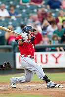Oklahoma City RedHawks outfielder Andrew Alpin (8) follows through on his swing during the Pacific Coast League baseball game against the Round Rock Express on August 1, 2014 at the Dell Diamond in Round Rock, Texas. The Express defeated the RedHawks 6-5. (Andrew Woolley/Four Seam Images)