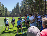 Lisa Cornwell gives a fan a autographed hat after hitting him in the back with her tee shot during the ACC Golf Tournament at Edgewood Tahoe Golf Course in South Lake Tahoe on Sunday, July 14, 2019.